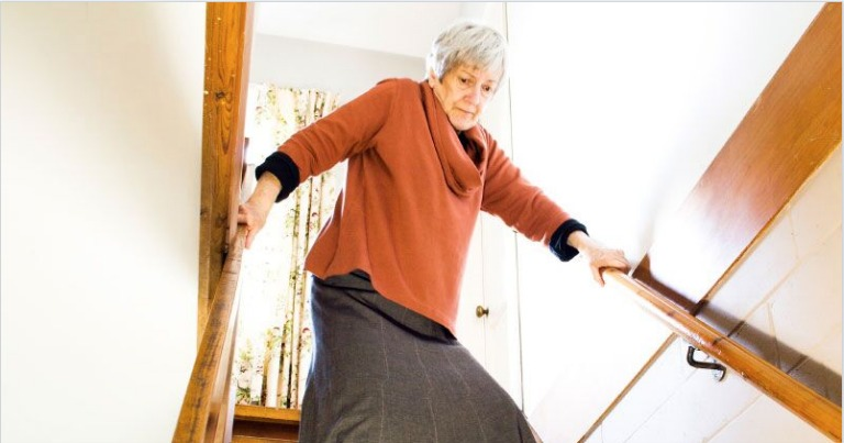 senior woman stairs