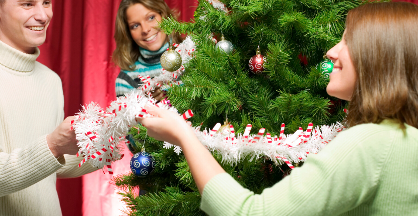 Family members decorating a christmas tree